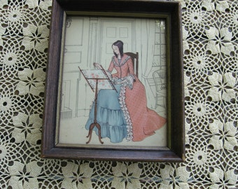 Framed Picture of a Woman Embroidering