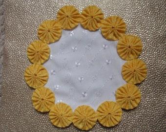 Sunshine Yellow Yo Yos on White Eyelet Doily Penny Rug Style Candle Mat