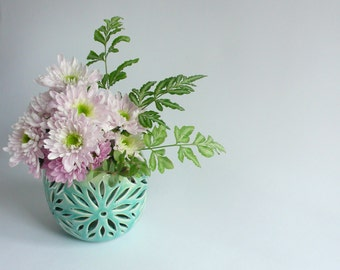 Wheel throwing double wall pot with daisy pattern