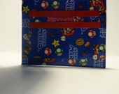 handmade duct tape mini wallet with super mario brothers all over it