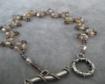 Affordable elegance. Swarovski crystal and seed bead bracelet in Topaz colors