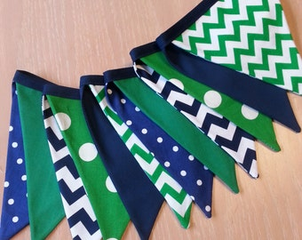 Fabric pennant banner in patterns of navy and green