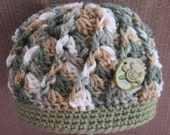 Crochet baby beanie with ceramic sea turtle on front