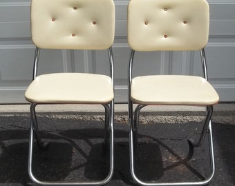 Set of Two 1950s Krome-Fold All Purpose Chairs, by Lee Industries Chicago, IL Cream Vinyl, Chrome, Button Tuft and Studded Back, Folding