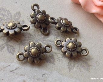 10 x 16 mm Antique Bronze Sun Flower Charm Connectors (.tctg)