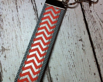 Coral with silver chevron print key fob wristlet on grey cotton webbing with swivel lobster clasp