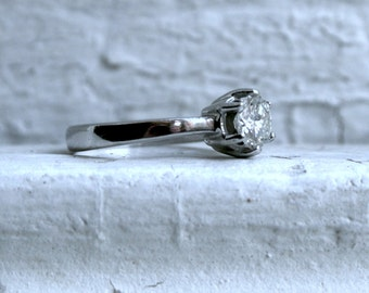 Vintage Platinum Diamond Solitaire Engagement Ring - 0.65ct.