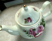 Elegant Baum Bros Formalities Porcelain Teapot with Rose Pattern