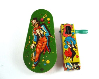 2 US Metal Tin Lithograph Noisemakers Vintage
