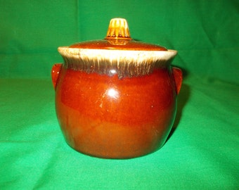 One (1), Individual Bean Pot, with Lid, from Hull China, in the Brown Drip Pattern.