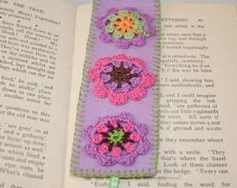 Crocheted motilfs on purple wool felt bookmark with green checked ribbon tails hand stitched by Lynwoodcrafts