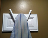 Ironing board holder made from a kitchen cabinet door