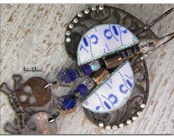 "Bohemian earrings ""The Tribal Rock"" Czech beads-oxidized metal and indigo photographs-rhinestones and skull."