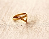 Gold ring: stacking ring with a small triangle.