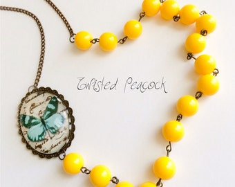 Yellow beaded necklace, butterfly necklace, aqua, beaded necklace, yellow, asymmetrical necklace, aqua