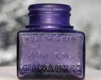 Original antique INK WELL embossed DIAMOND Ink - beautiful Deep Translucent Purple Amethyst color - dated 1903 !