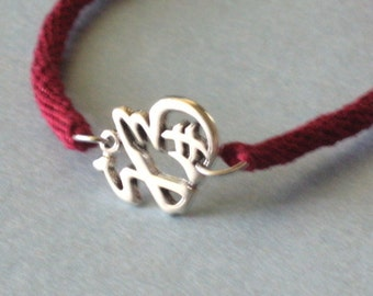 Good luck symbol - red Kumihimo bracelet - sterling silver - with magnetic clasp