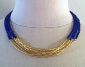 Blue and gold bead multistrand necklace by Cerise Jewelry