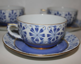 Lot of four hand painted Sinikka teacups and saucers by Arabia Finland