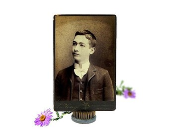 Antique cabinet card portrait of a young man vintage photography mounted on board dark sepia photographic print New York City studio c 1880