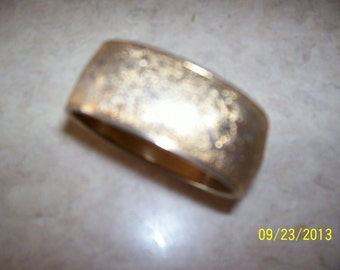 "Goldish frosted bangle, 2-1/2"" x 1"""
