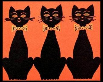 Fridge Magnet three Black Cats all in a row vintage image Orange background