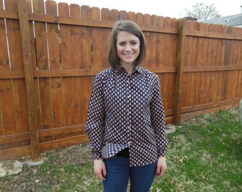 Vintage 1980's long sleeved, geo-print blouse with navy blue and pink design.