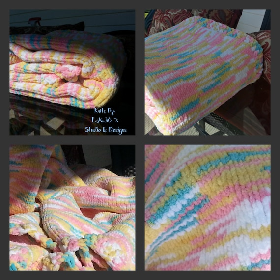 Hand knitted baby blanket soft chenille yarn.