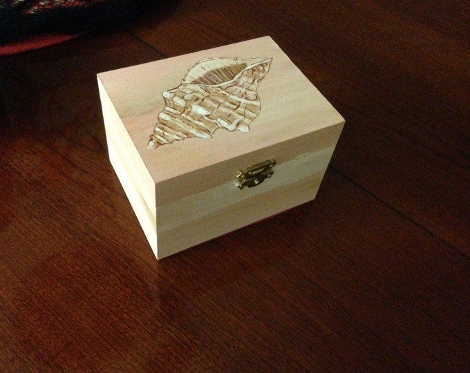 "5""x3 1/2"" x 3"" solid wood box with lid and latch. Acrylic painted Sea Shell on Top. Sealed and lined with felt."