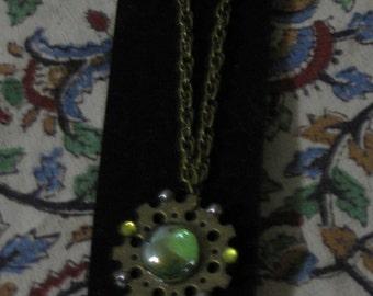 Green & Goldtone Sea Glass Gear Pendant