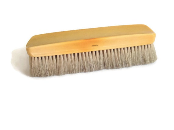 vintage clothes brush celluloid with bristles yellow