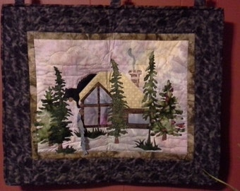 Log cabin quilted wall hanging