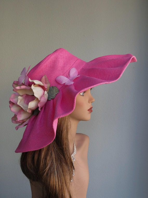 This is a beautiful hot pink pillbox hat with a hand-made silk flower. The fascinator is completely hand made using traditional millinery techniques and a lot of skill and attention to detail.