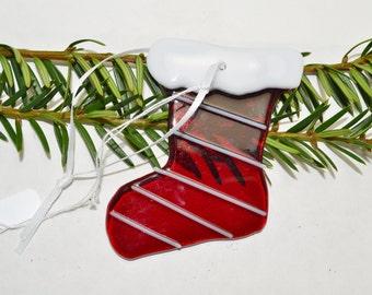 Glass Christmas stocking ornament.