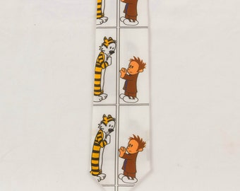 Necktie featuring Calvin Attentive Hobbes British phone booth Fabric is printed in the form of a Comic strip