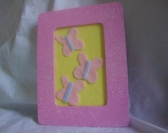 Handmade My Little Pony picture frames-Fluttershy cutie mark decoration.