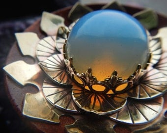 Opalite Brass Lotus Plugs on Blood Wood