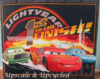 Padded twin sized headboard with Pixar's Cars movie theme