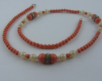 Magic necklace of plastic beads (coral optic and artificial pearls). 50s fashion jewelry. Vintage