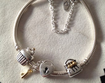 Authentic Pandora Bracelet with mixed metals charms