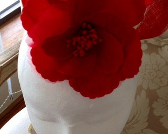 Cute red flowered fascinator with sinamay loops. Made to order!