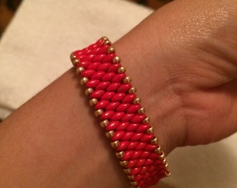 Coral colored Super Duo Bracelet in goldtone