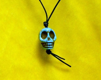 Small Turquoise Colored Clay Skull on a Thin Adjustable Black Leather Cord Necklace 01