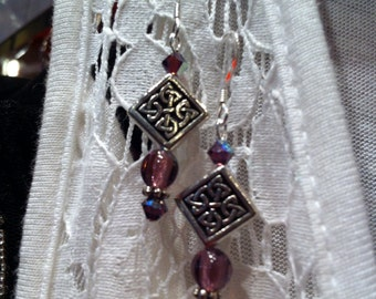 Amethyst and sterling silver pierced earrings with Celtic knot beads.
