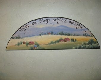 """Wooden Plaque arch shape """" Enjoy all things bright & beautiful""""...features a soothing rural scene with country homes and rolling hills."""