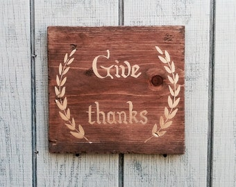 "Gold ""Give Thanks"" wood sign"