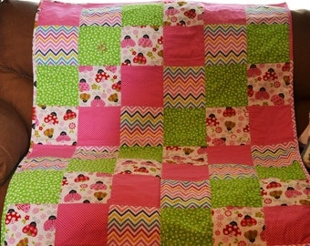 Pink and green ladybug baby quilt