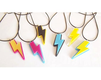 Laser cut double layer lightning bolt necklace on black rubber cord