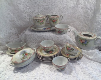 Miniature Dinnerware Set, Made in Japan Circa 1950's.  22 pieces bone china, some missing pcs and some flaws.