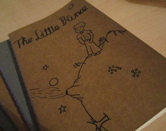 Hand Drawn The Little Prince Moleskine Ruled Journal, Small, Black on Brown.